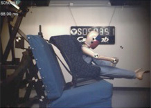 Crash test of dummy in forward facing child car seat